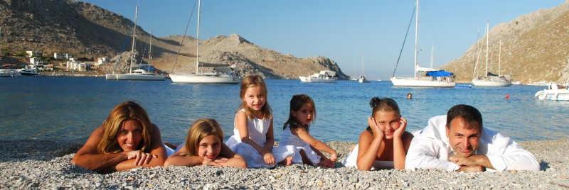 Family in pedi, Symi.