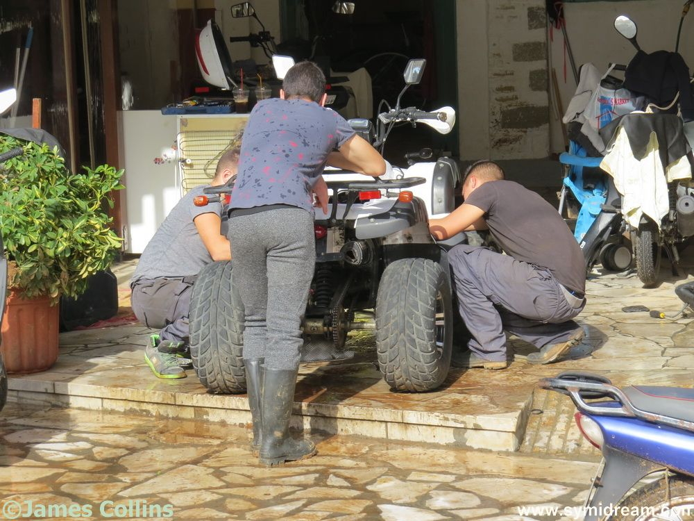 The boys at Backstreet Bikes getting what vehicles they have left back on the road.