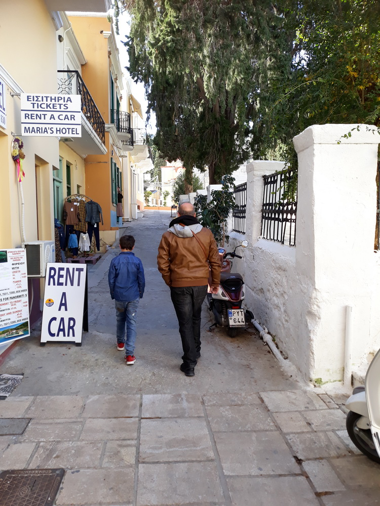 Off to collect a delivery from the book shop, one of the courier agents on Symi