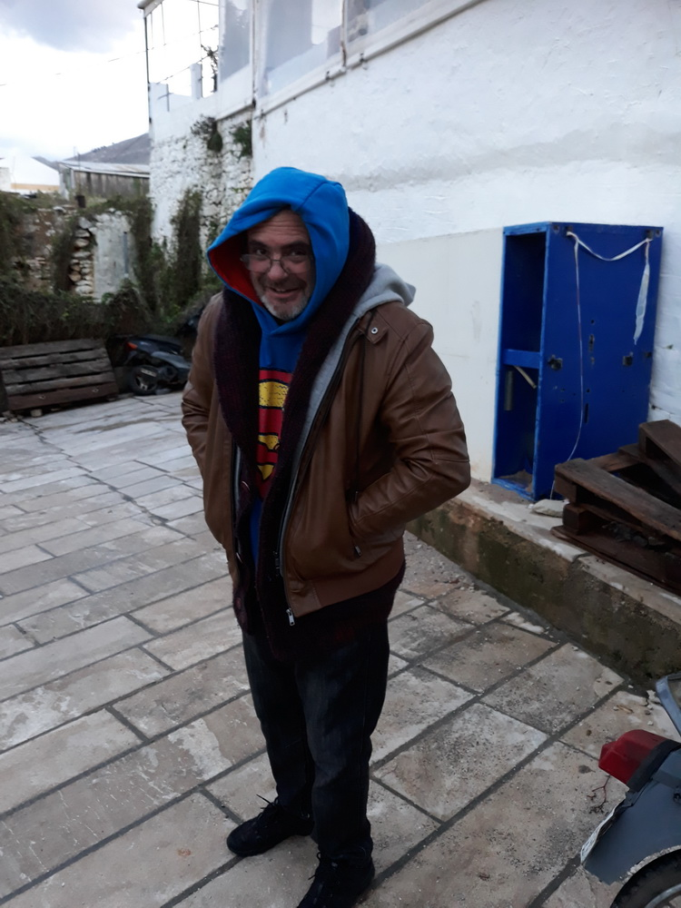 That's a thermal vest, sweatshirt, knitted jumper with hood, hoodie with hood, jacket, with hood and a smile. The 'keeping warm on Symi' starter kit.