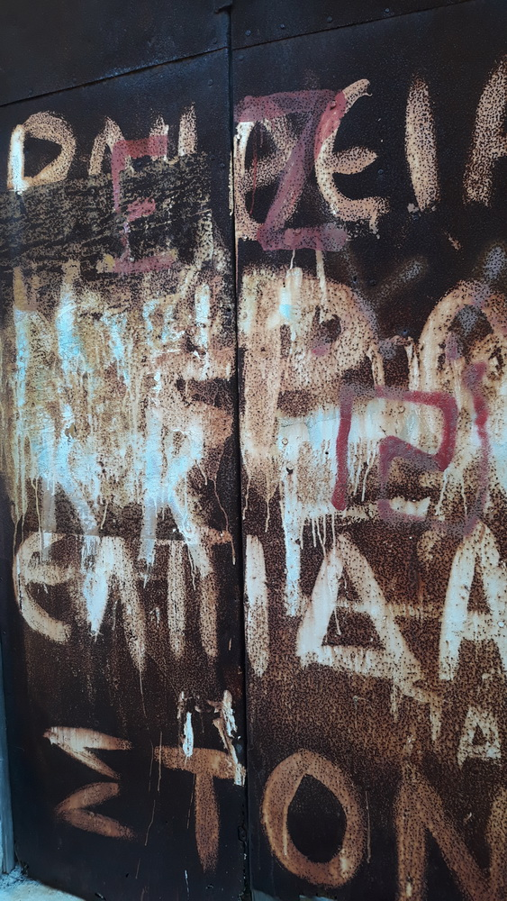 Old graffiti on a rusty door.